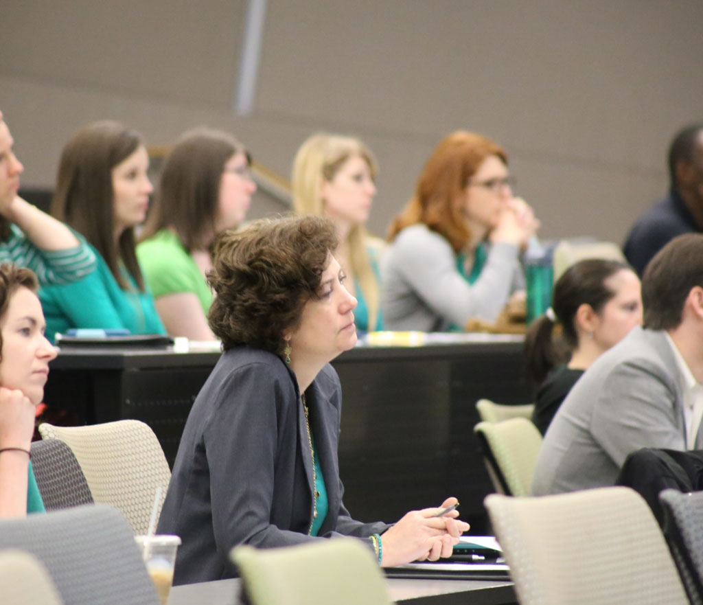 group of faculty listening to a presentation